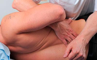 Грижа позвоночника: симптоми и лечение